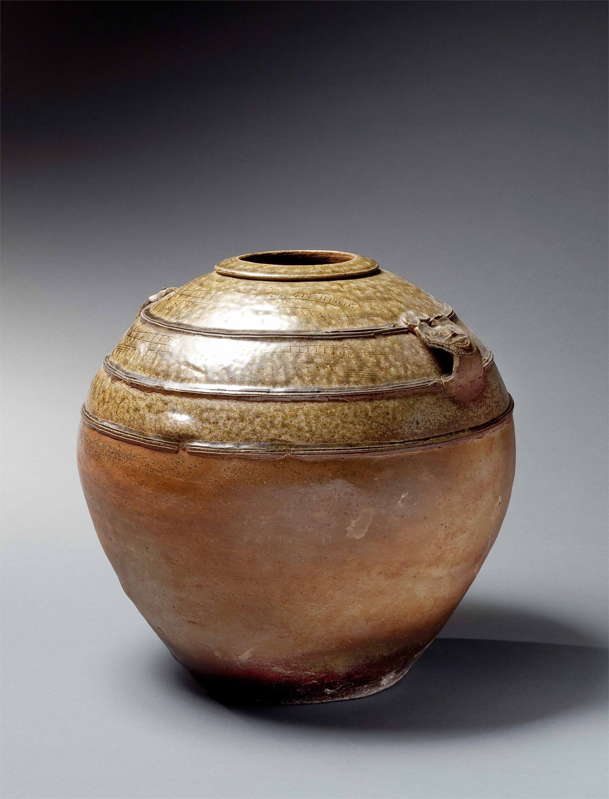 ASH-GLAZED JAR WITH DECORATION ON SHOULDERS