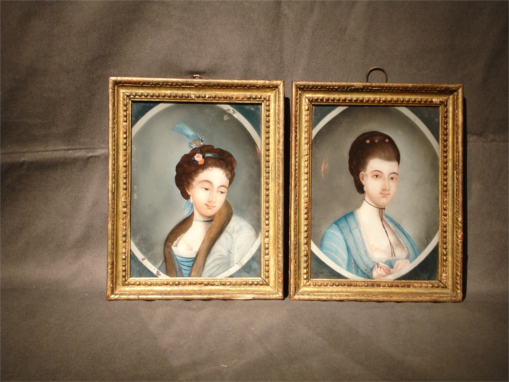 PAIR OF REVERSE PAINTINGS ON GLASS WITH EUROPEAN LADY IN A MEDALLION