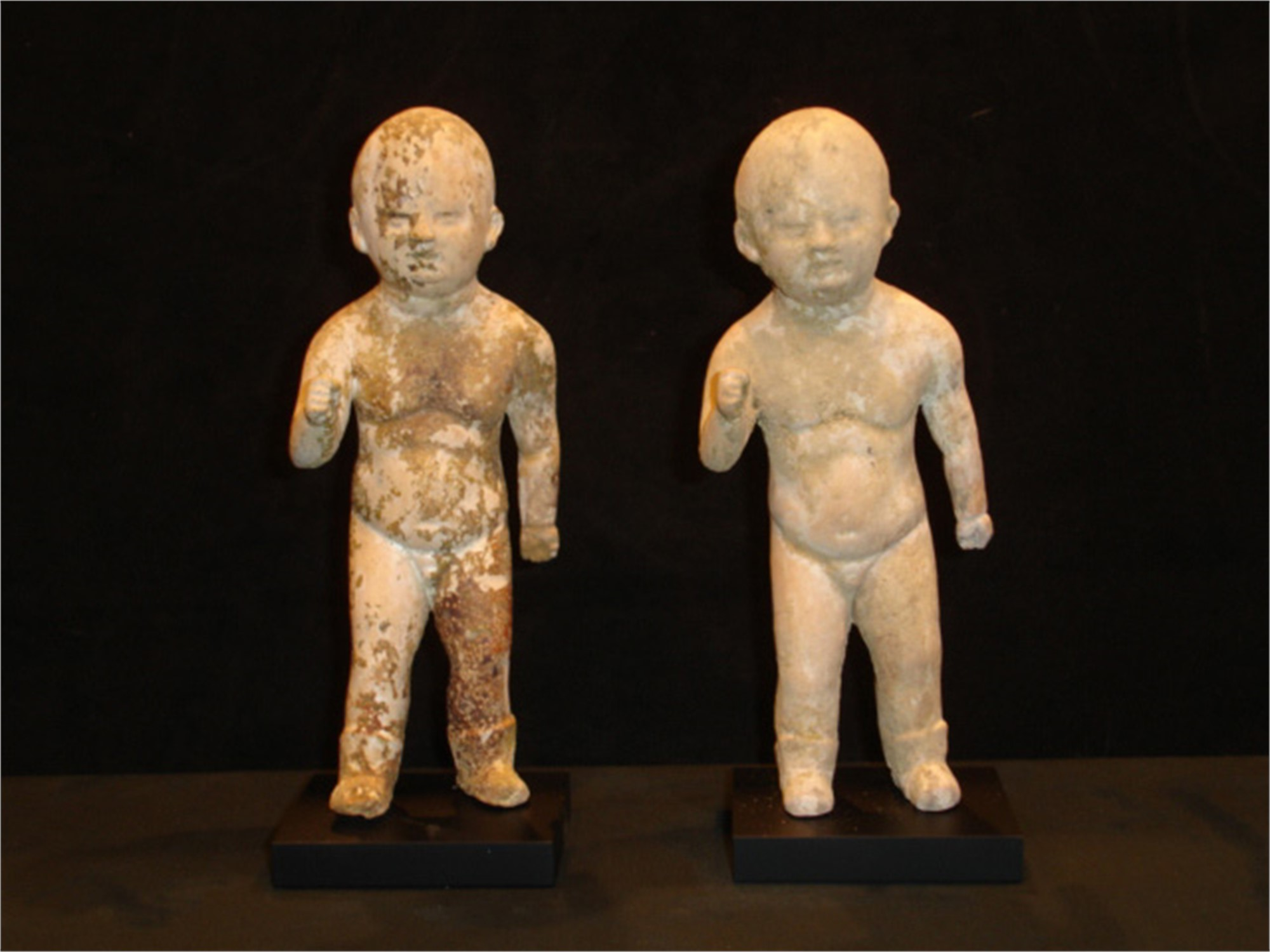 TWO SMALL PAINTED POTTERY FIGURES OF CHILDREN