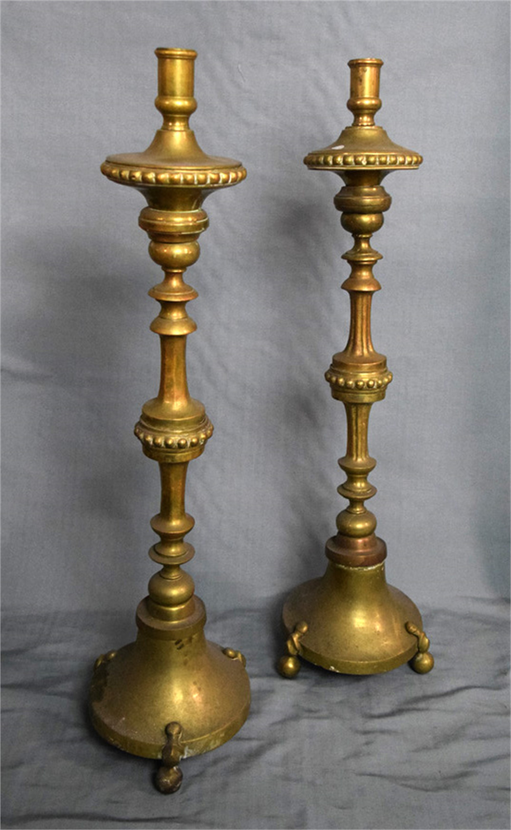 PAIR OF CONTINENTAL, BAROQUE STYLE BRASS ALTAR STICKS