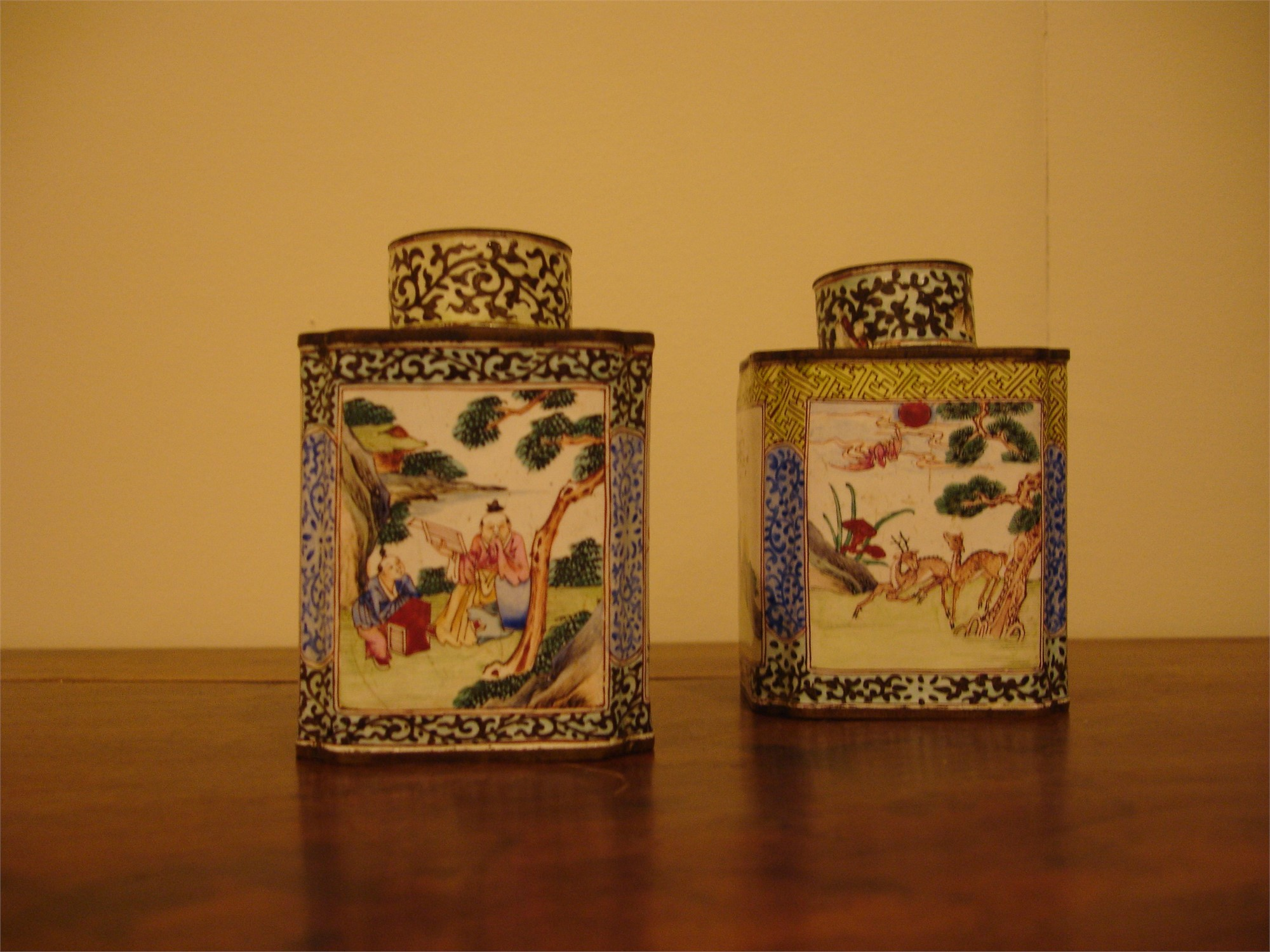 SMALL ENAMELED CANISTER AND COVER WITH FIGURAL/FLORAL VIGNETTES