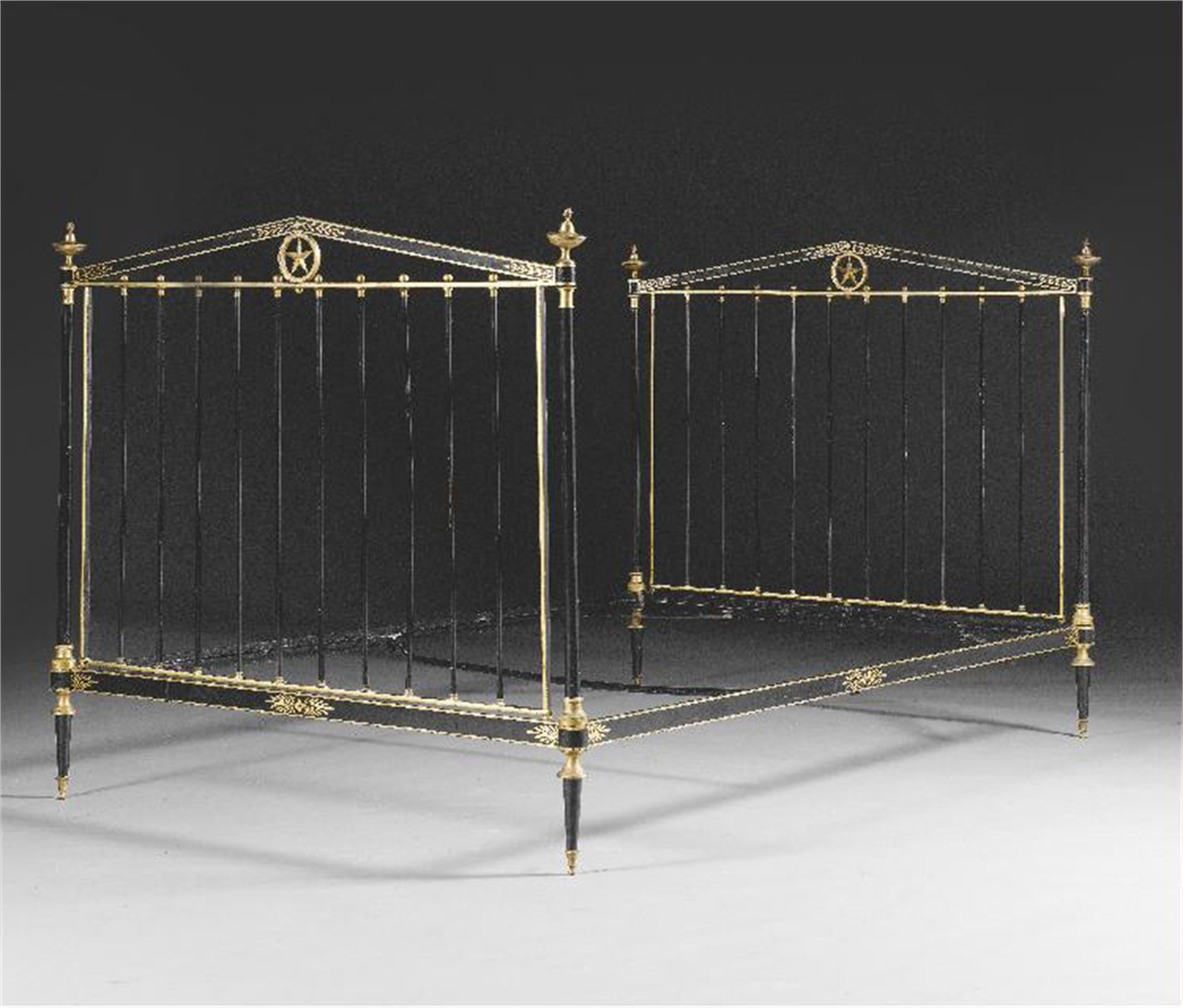 FRENCH GILT-BRONZE MOUNTED PARCEL-GILT AND BLACK PAINTED STEEL BED by Emilo Terry
