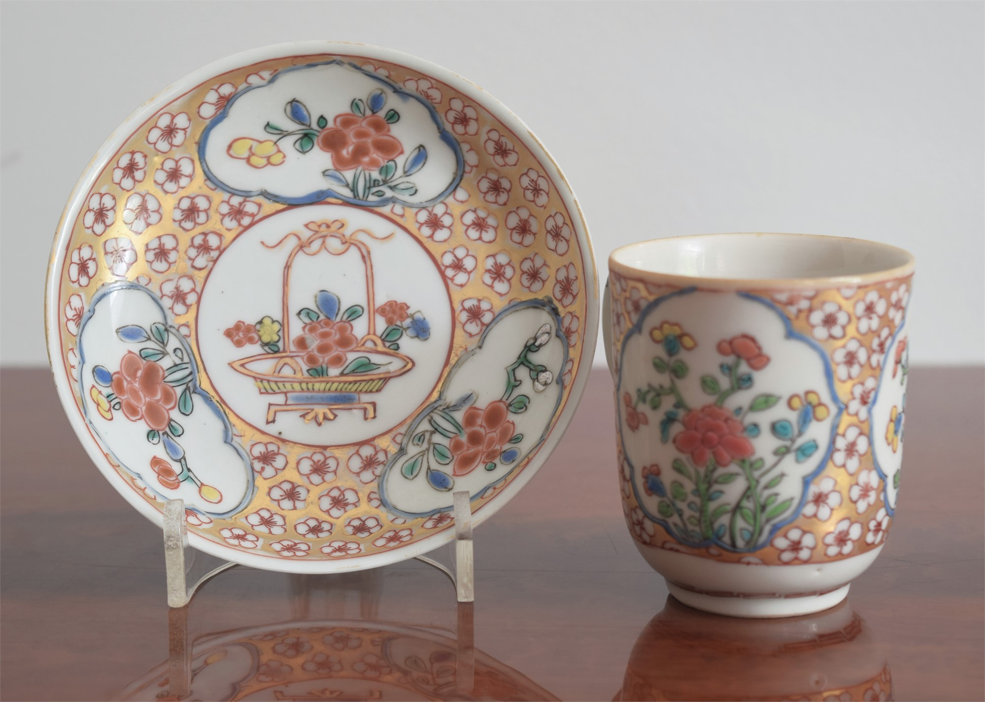 FAMILLE ROSE CUP AND SAUCER WITH FLOWERS AND GILT DIAPER