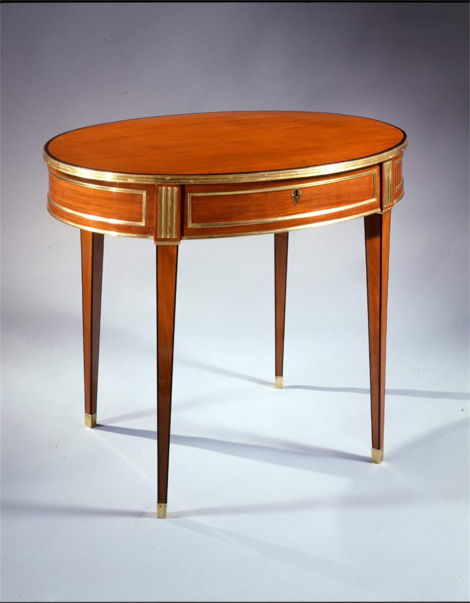 RUSSIAN BRASS MOUNTED MAHOGANY OVAL TABLE