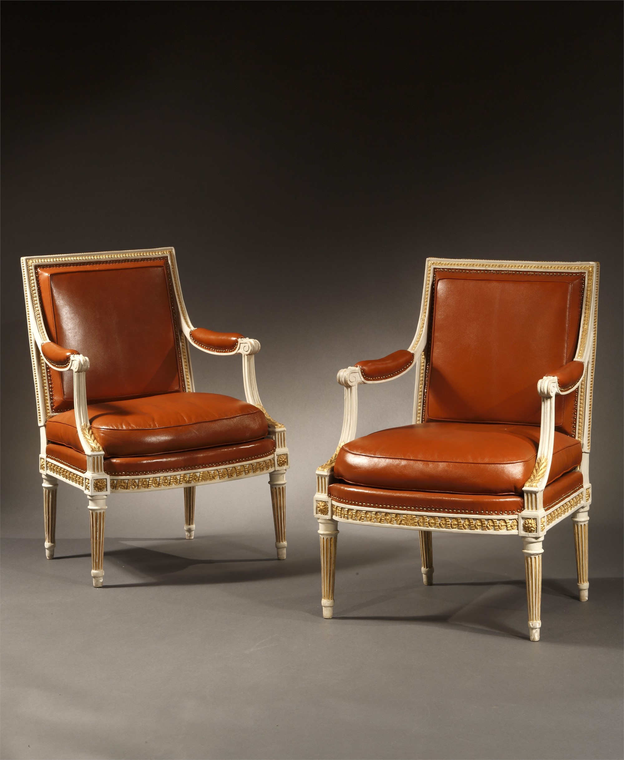 PAIR OF LOUIS XVI PAINTED AND PARCEL GILT FAUTEUILS STAMPED H. JACOB by Henri Jacob