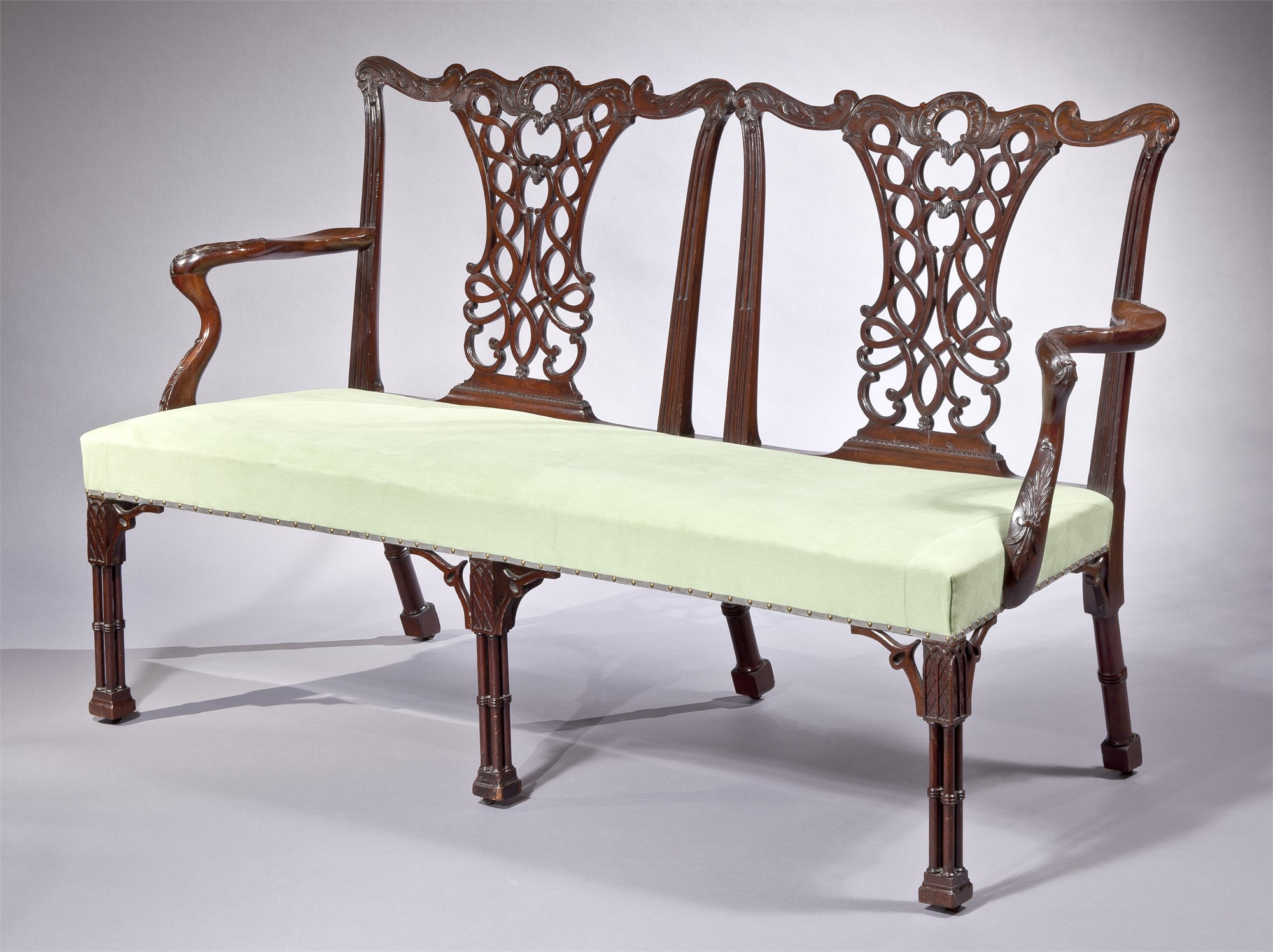 CHIPPENDALE MAHOGANY TWO-CHAIR SETTEE