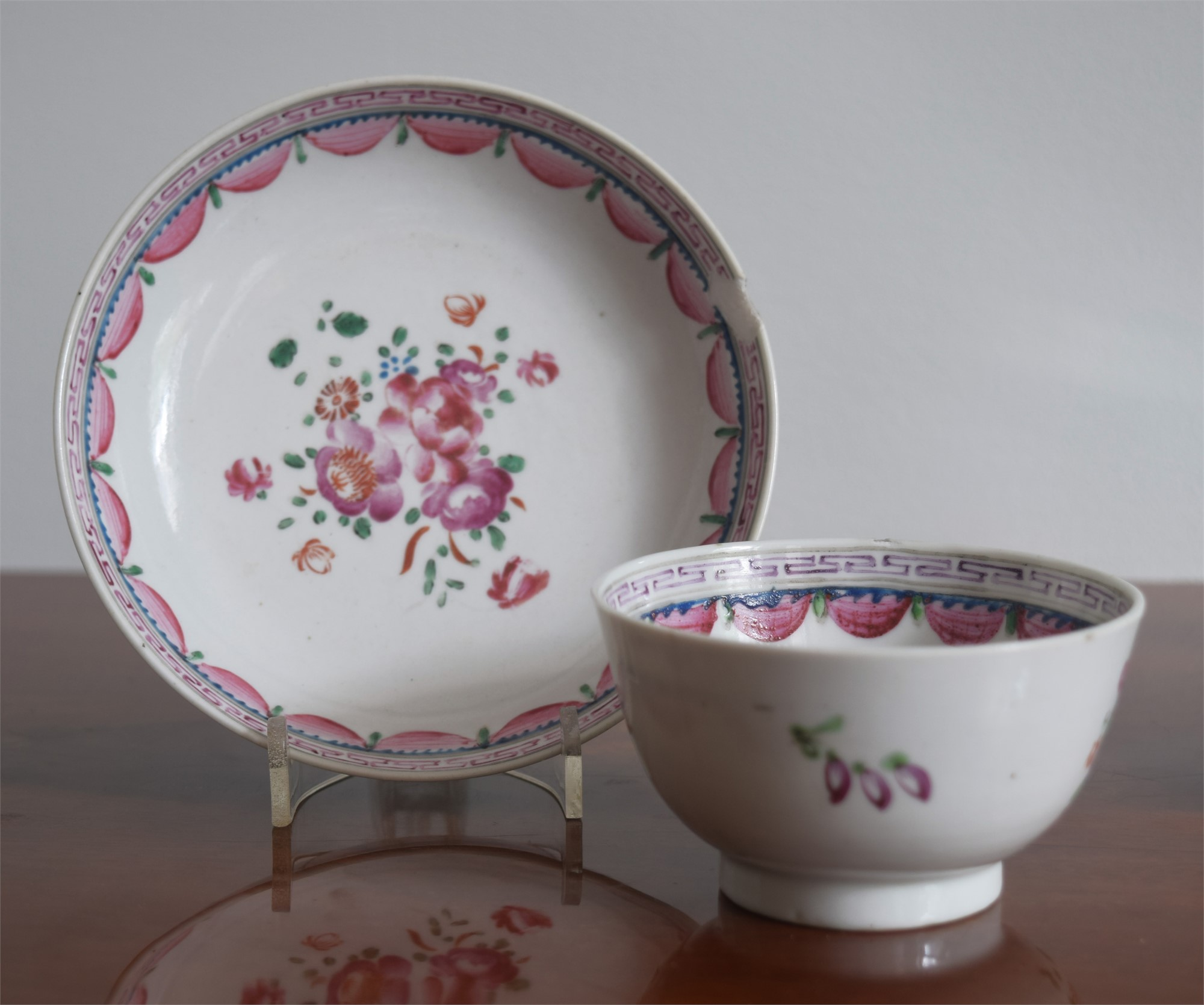 A FAMILLE-ROSE CUP AND SAUCER IN THE ENGLISH STYLE