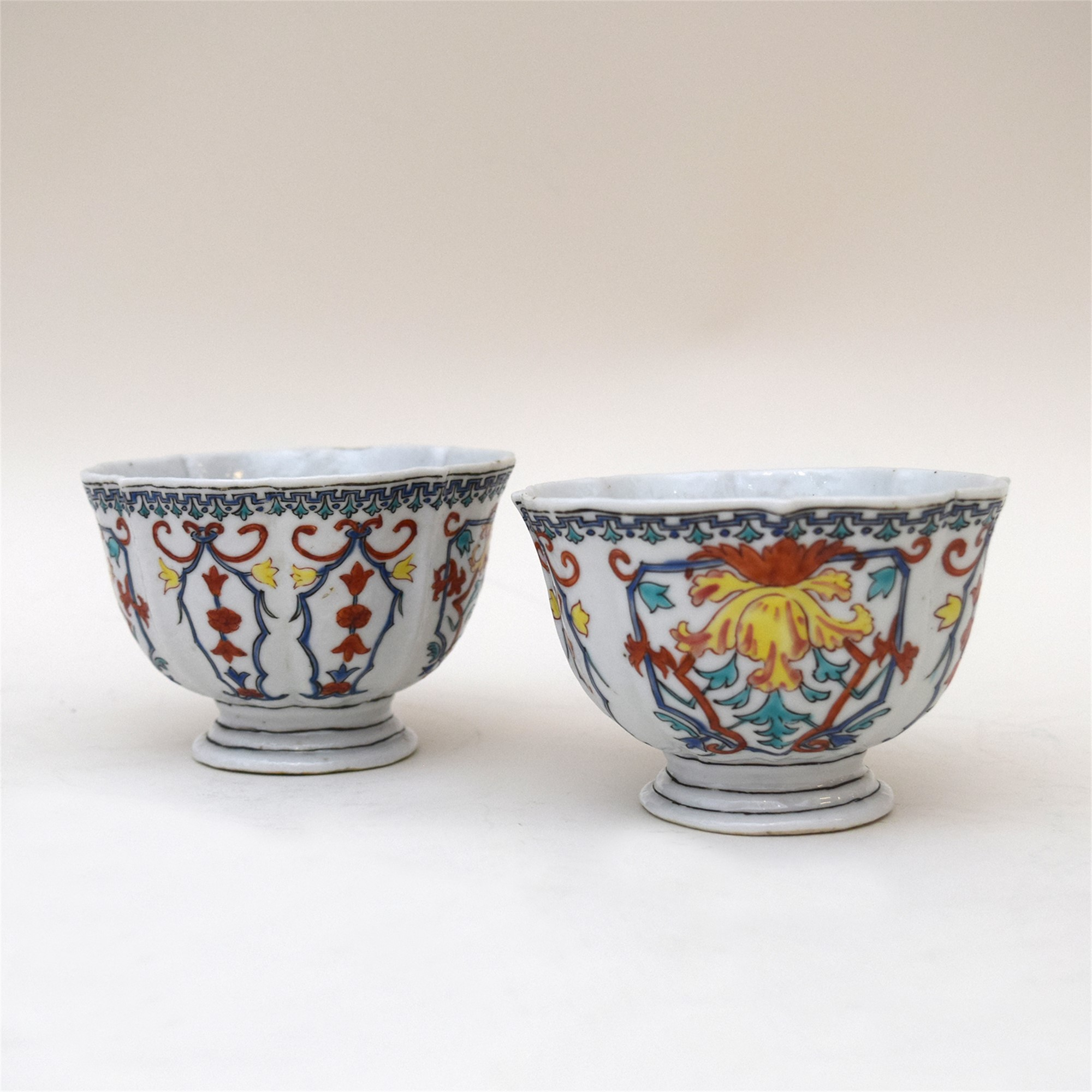 PAIR OF POLYCHROME FOOTED BOWLS AFTER VEZZI