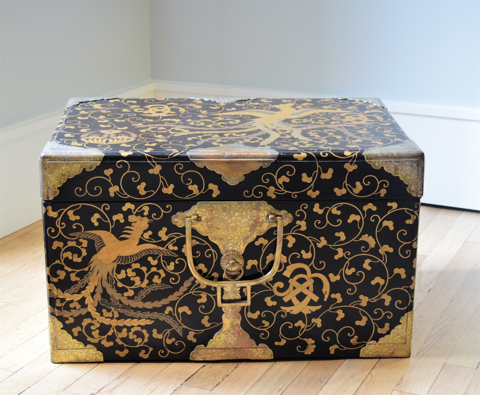 BLACK AND GOLD LACQUER STORAGE CHEST WITH ETCHED BRASS MOUNTS