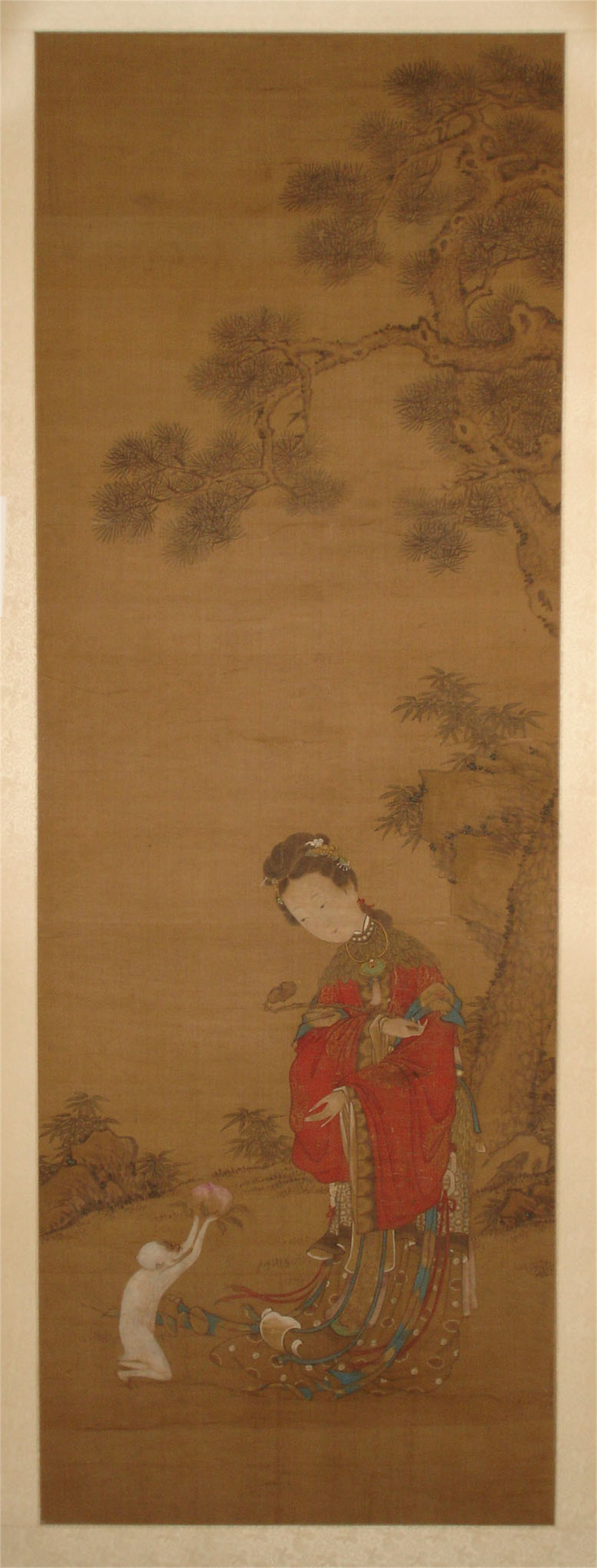 CHINESE SILK PAINTING OF A MONKEY OFFERING A PEACH TO A LADY