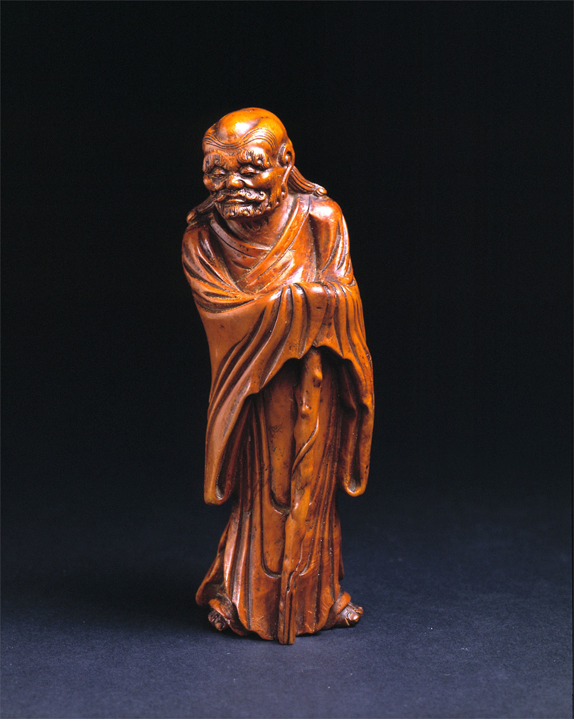 BOXWOOD CARVING OF A GENTLEMAN WITH STAFF