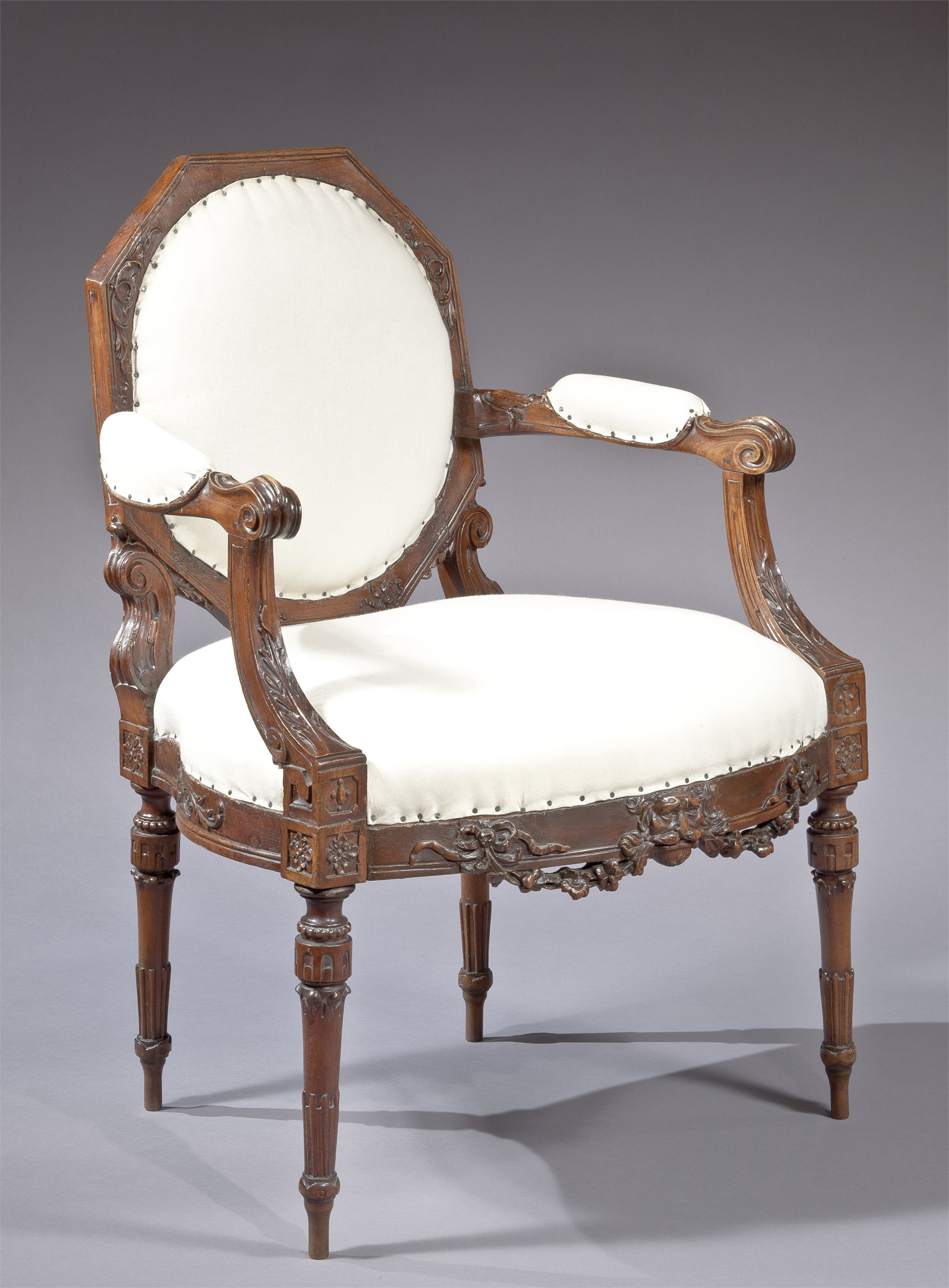 UNUSUAL CONTINENTAL NEOCLASSICAL CARVED MAHOGANY ARMCHAIR