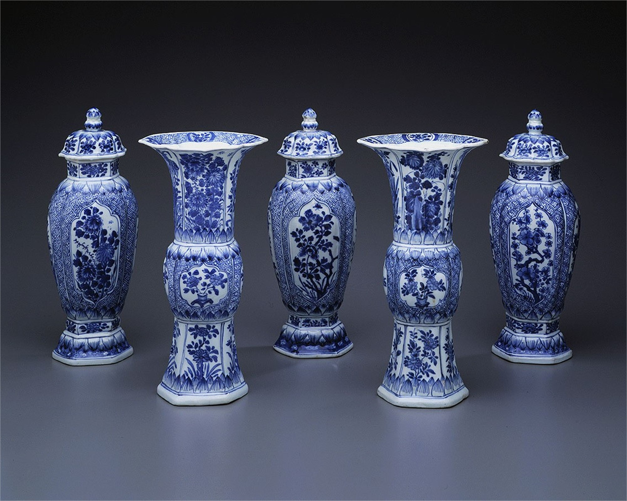 FIVE PIECE BLUE AND WHITE GARNITURE WITH FLORAL PANELS