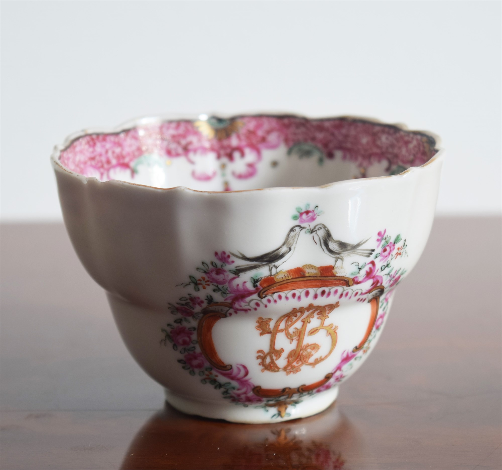 A FAMILLE ROSE INITIALED COFFEE CUP