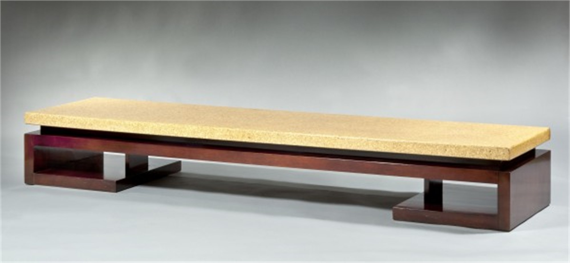 A LONG LOW TABLE WITH CORK TOP BY PAUL FRANKL by Paul Frankl