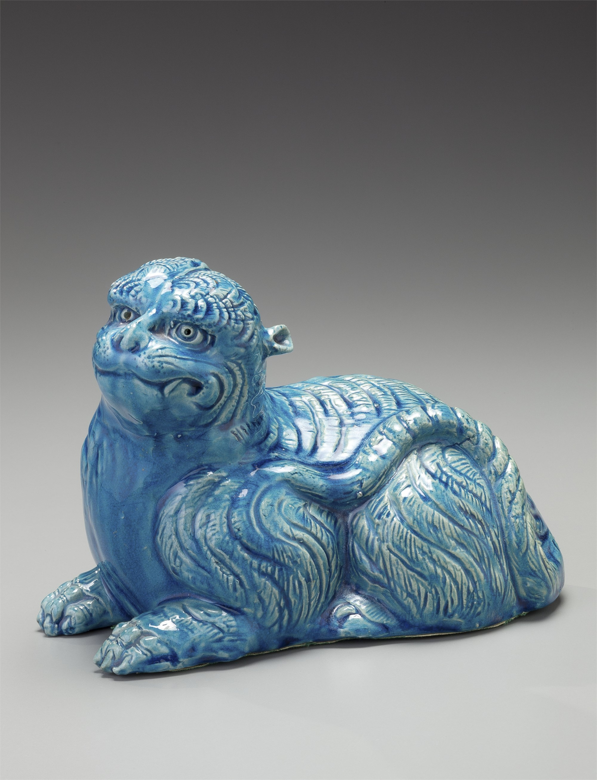 TURQUOISE SEATED DOG