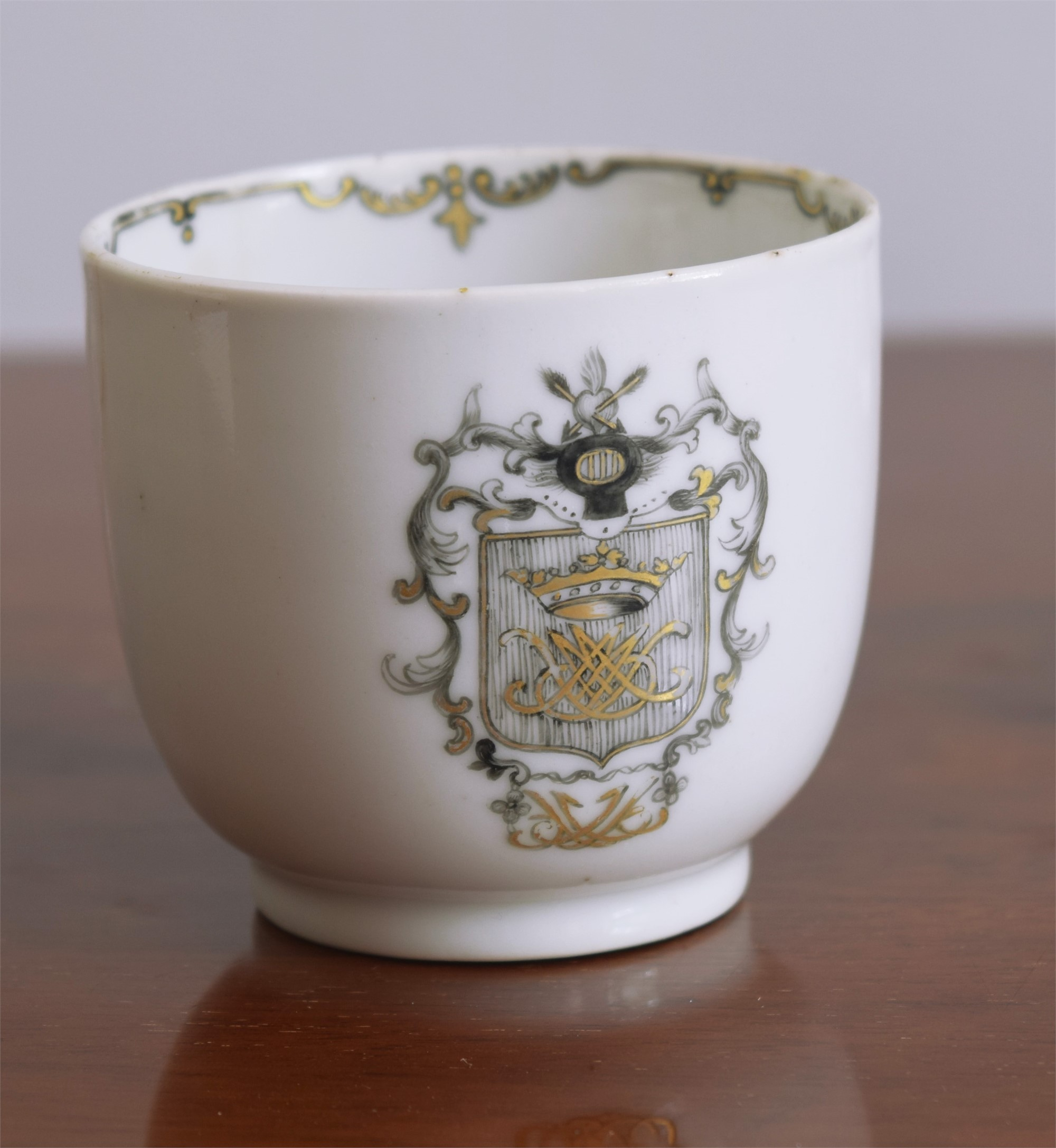 A GRISAILLE ARMORIAL COFFEE CUP