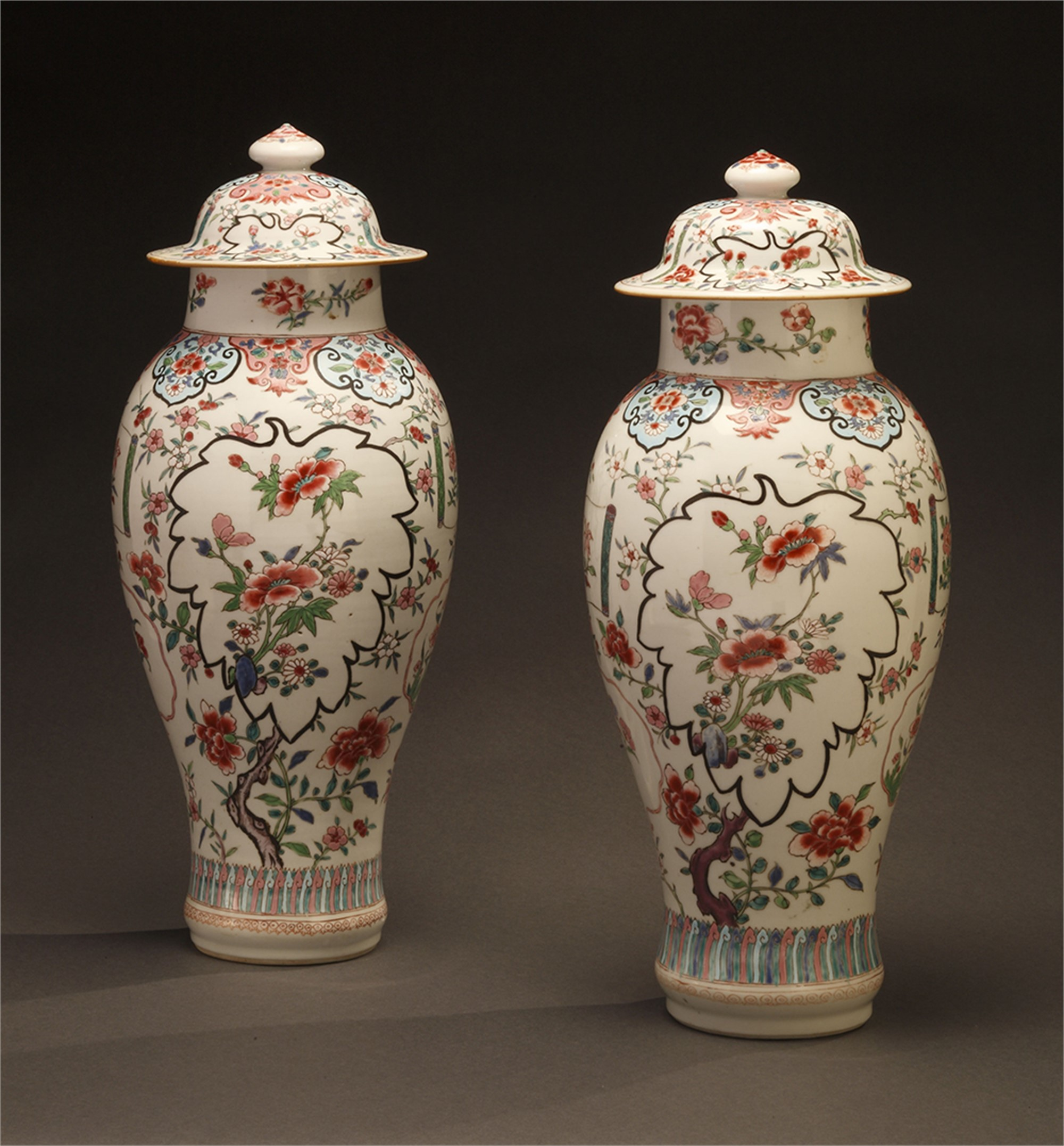 PAIR OF FAMILLE ROSE VASES AND COVERS
