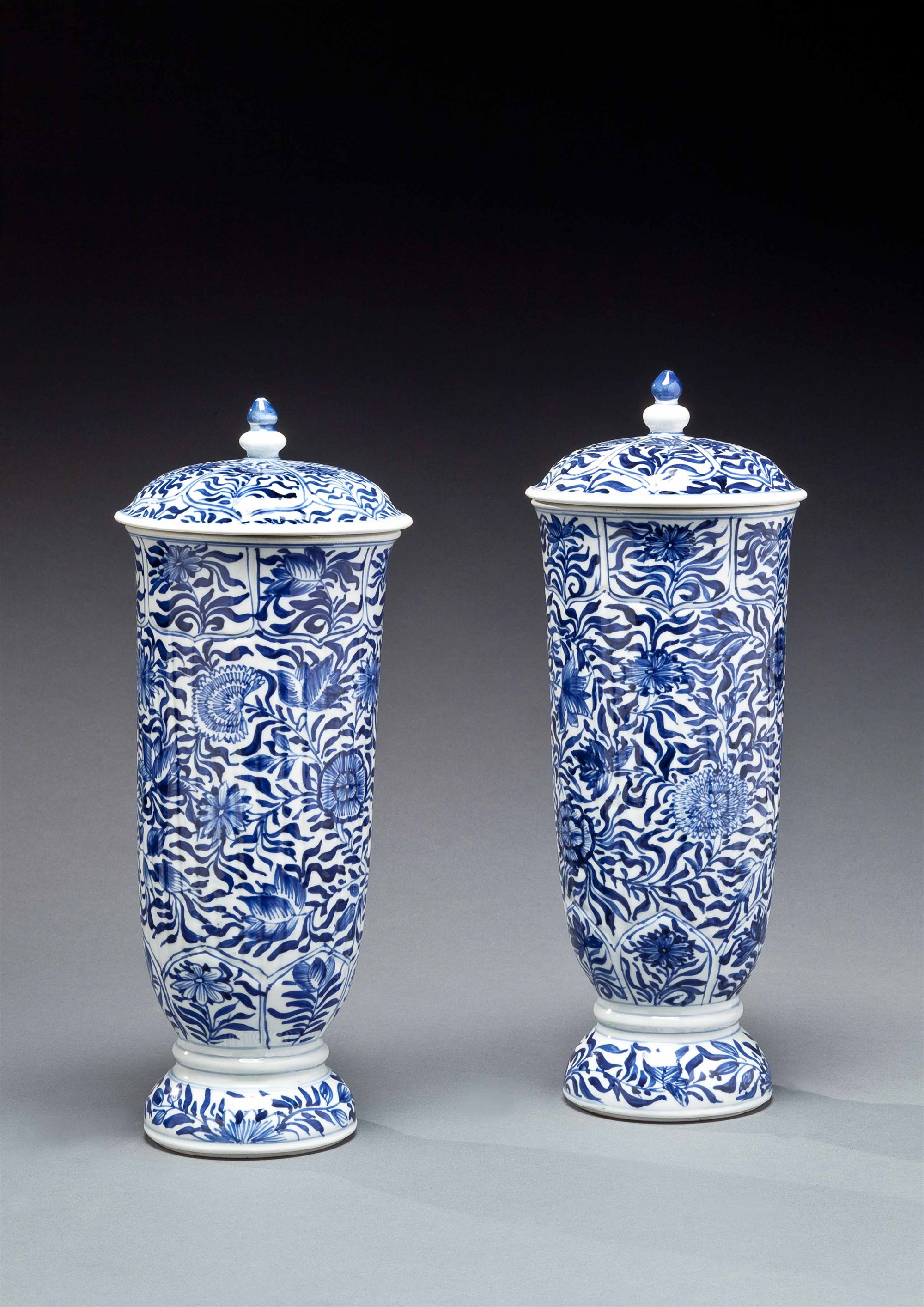PAIR OF BLUE AND WHITE TALL FLUTED BEAKERS AND COVERS
