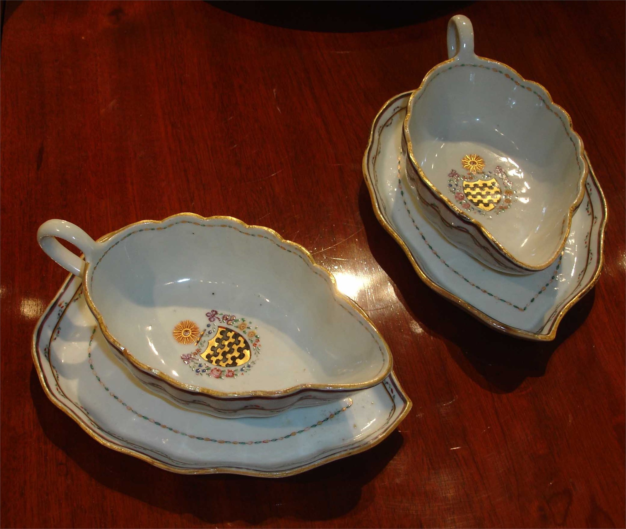 PAIR OF ARMORIAL GRAVY BOATS ON STANDS WITH ARMS OF BLUNT