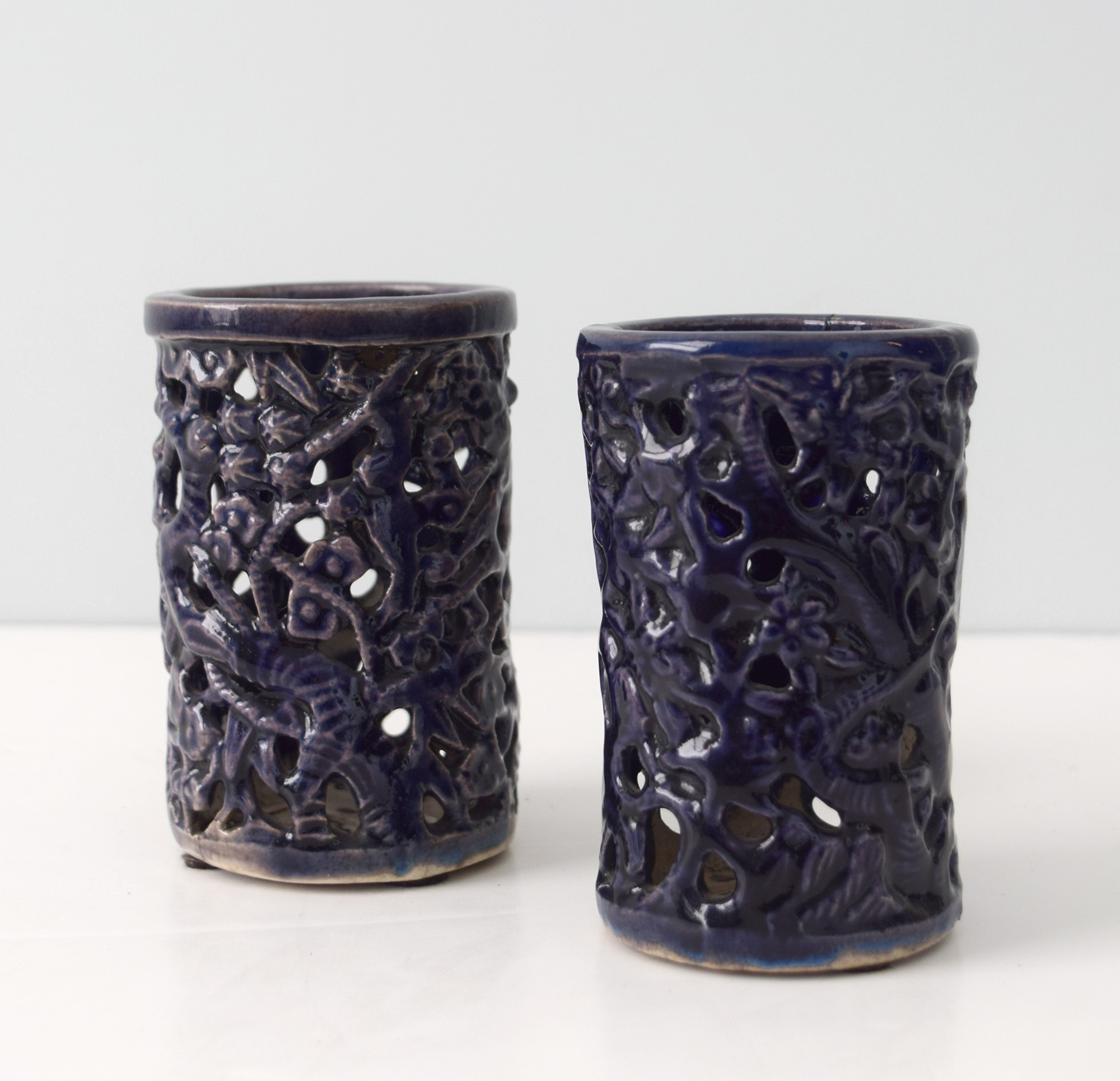 PAIR OF SMALL AUBERGINE RETICULATED BRUSHPOTS WITH BRANCHES