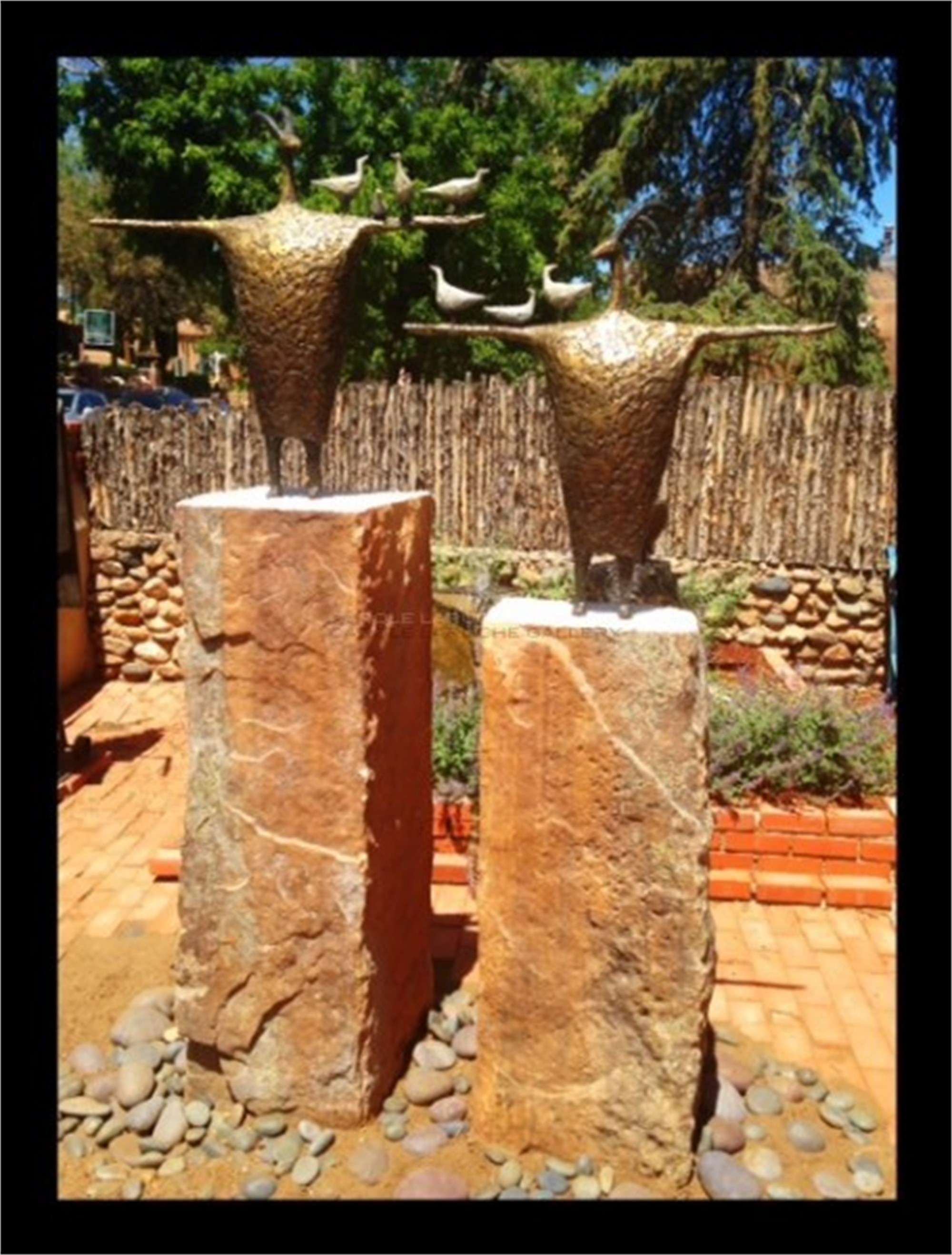 "PROTECTORS OF THE MIGRATION Sculptures 34""x33""x10"" $6000 each Two Rock Pedestals $7500 OR Two Sculptures with Two Rock Pedestals $18,500. May be purchased separately or together. by Jill Shwaiko"