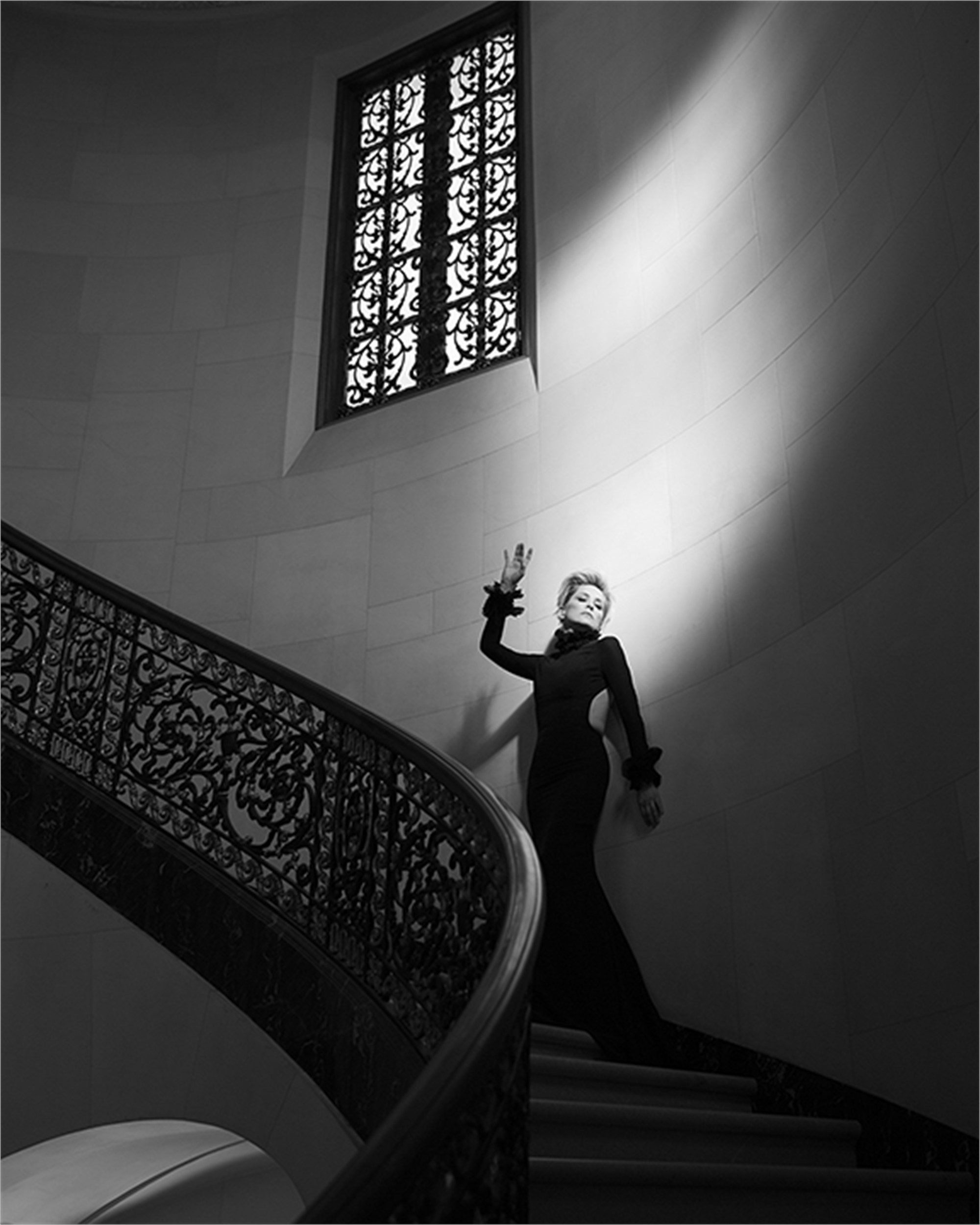 16004 Sharon Stone Against Wall on Staircase BW by Timothy White
