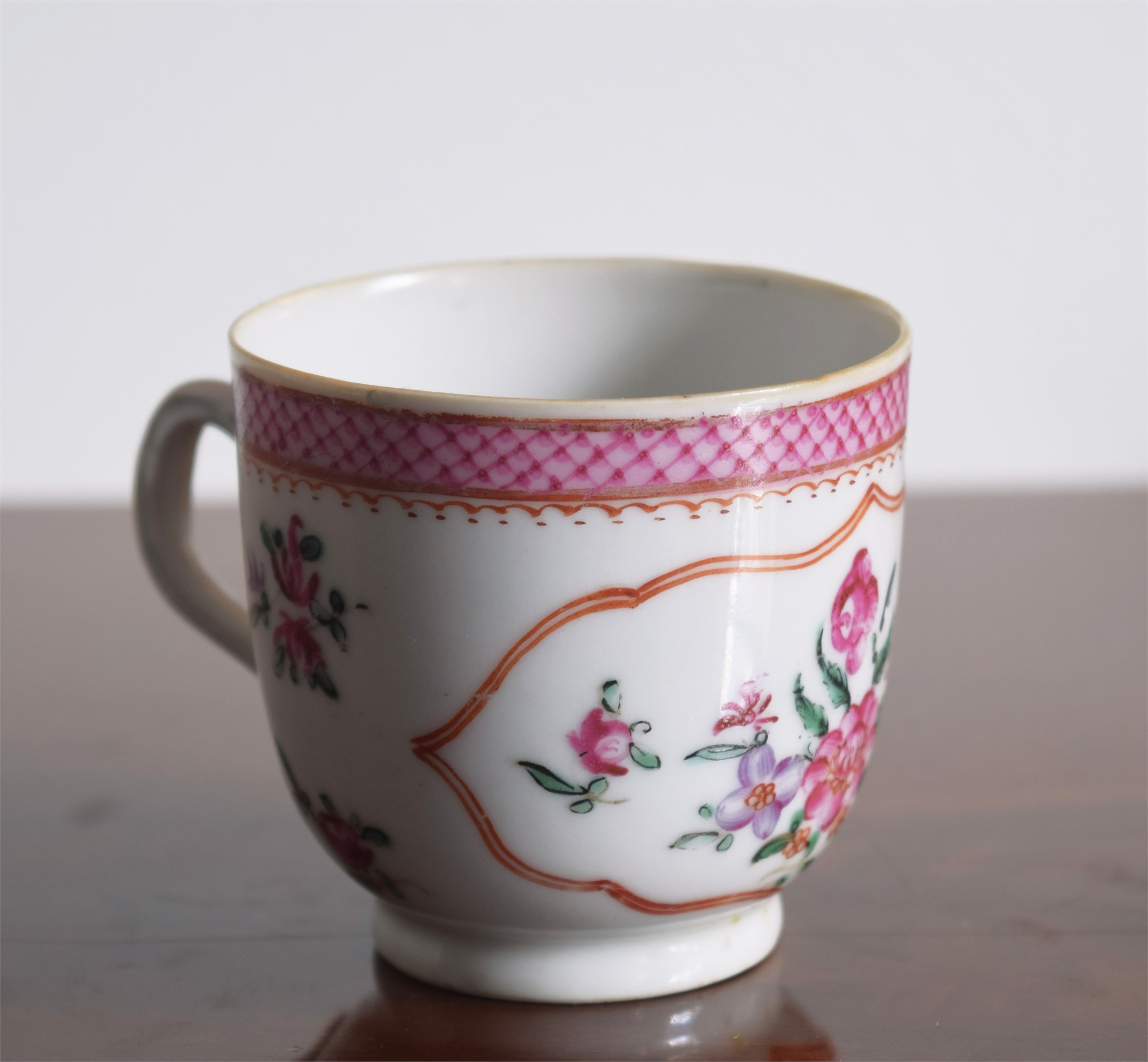 A FR COFFEECUP WITH CENTRAL FLOWER, SMALL PUCE FOLIAGE