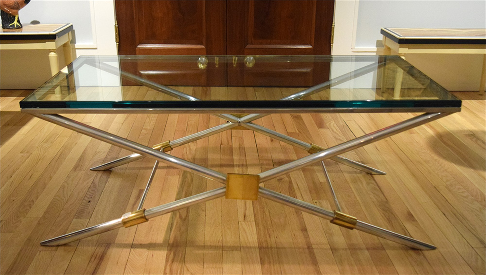 ALUMINUM AND BRASS COFFEE TABLE WITH GLASS TOP by John Vesey