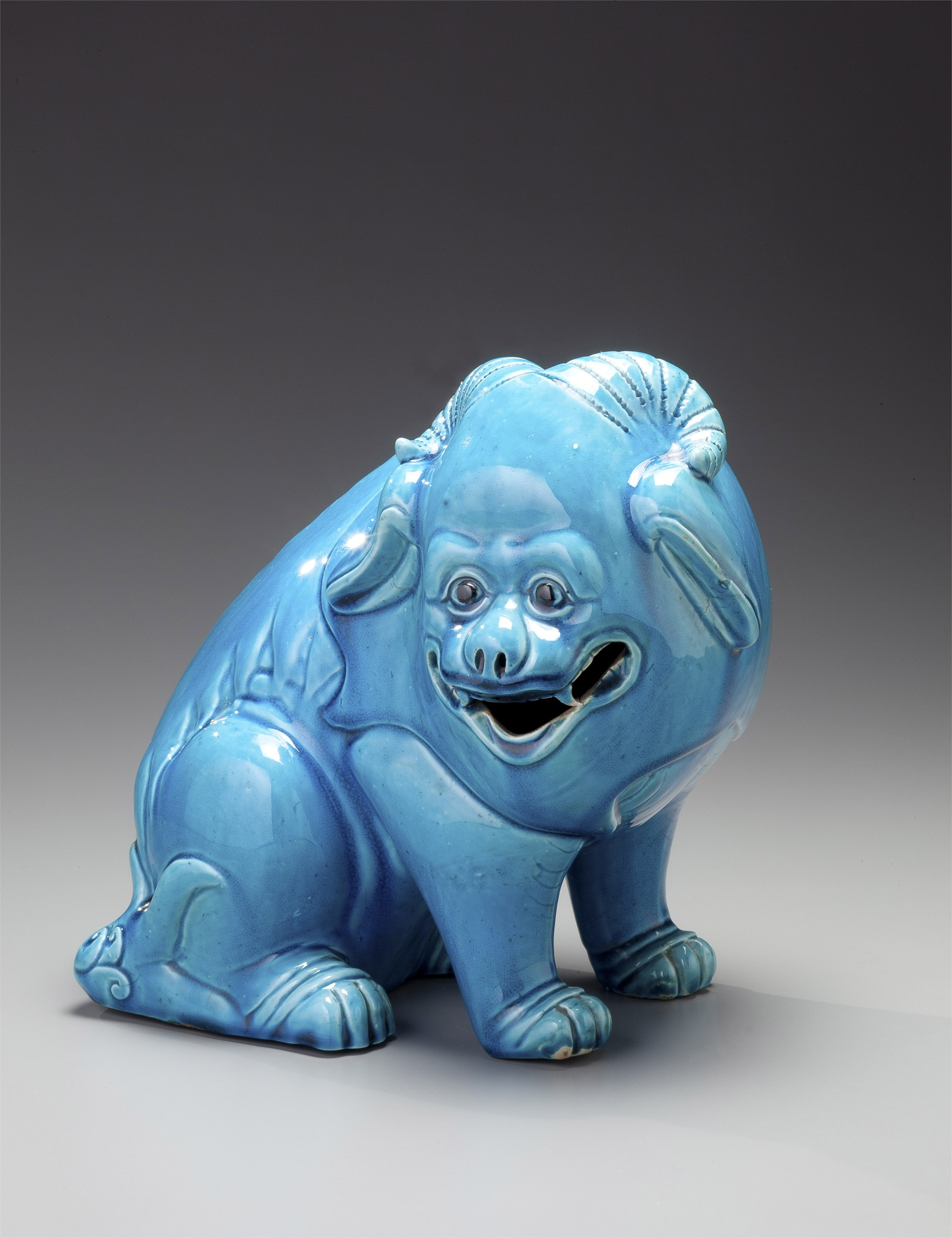 TURQUOISE SEATED DOG WITH TWO HORNS