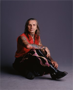 03055 Indian Larry Red Vest Seated on Floor Color, 2003