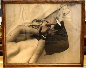 FRAMED PHOTOGRAPH OF A MAN TIED WITH A ROPE, Feb 25, 1990
