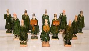 SET OF 12 GREEN-GLAZED POTTERY ATTENDANTS, Ming Dynasty