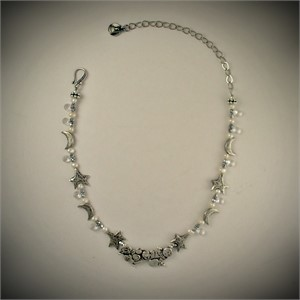 Necklace -  CLOUDS, STARS, & MOONS - A sterling silver drifting cloud form centers a strand of sterling silver stars and moons, separated by glass teardrops, pearls and silver Czech glass beads. Closure is hook and chain.  31921, 2019