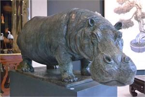 A BRONZE SCULPTURE OF A HIPPOPOTAMUS