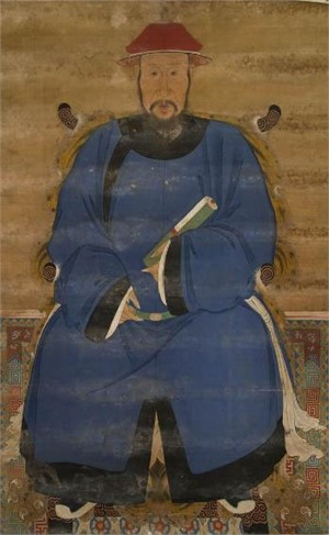 CHINESE ANCESTRAL SCROLL PAINTING OF AN OFFICIAL IN BLUE ROBES, Chinese, late 18th/early 19th century