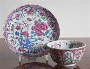 FAMILLE ROSE TEACUP AND SAUCER WITH CENTRAL FLOWER, 10 RESERVES, BLUE CELL AND PINK DIAMOND DIAPER BORDER