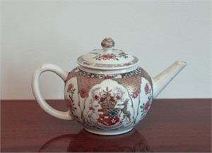 A TEAPOT AND COVER WITH ARMS OF PERCEVAL QUARTERING WARREN , Circa 1735