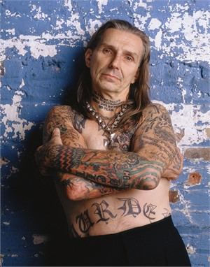 03055 Indian Larry Arms Crossed Blue Background Color, 2003