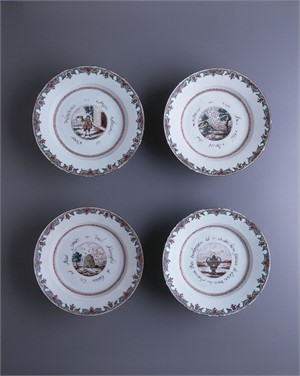 SET OF FOUR DUTCH DECORATED DISHES WITH CENTRAL SCENE OF URN, BEES, MAN AND LEAVES