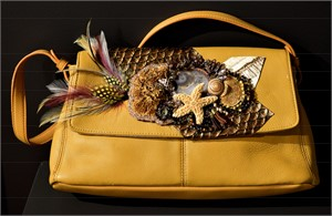 Ochre Leather Bag with Feathers, Fungus and Starfish
