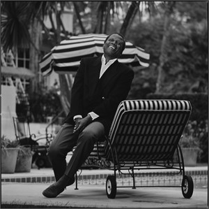 87125 Sidney Poitier Laughing on the Chaise BW, 1987