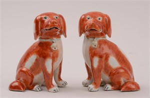 PAIR OF CHINESE EXPORT PORCELAIN FIGURES OF SEATED PUPS, Qing Dynasty
