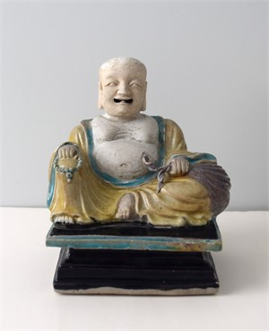 BISCUIT FIGURE OF PUTAI, Chinese, Qing Dynasty, 17th century