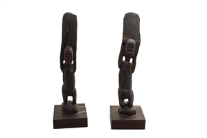 Two Rain Figures With Raised Arms