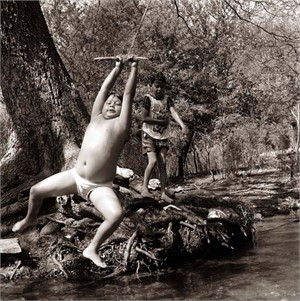 Kickapoo Boy Swinging, Nacimiento, Mexico (1/25), 1996