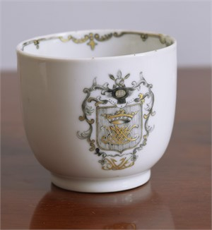 A GRISAILLE ARMORIAL COFFEE CUP, 18th century