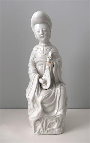 BLANC DE CHINE LADY PLAYING THE MANDOLIN, Chinese, 17th century