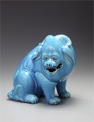 TURQUOISE SEATED DOG WITH TWO HORNS, Chinese, 19th century