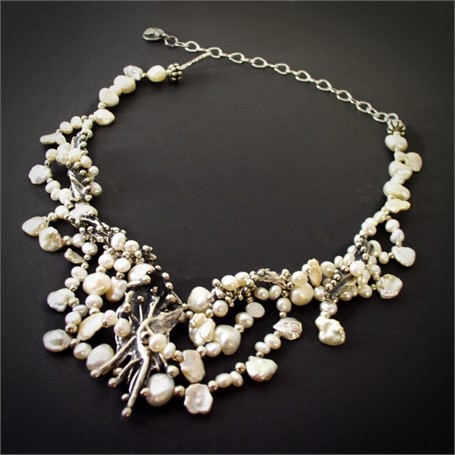 Necklace - Organic Silver and Pearl Collar- An organic silver centerpiece has silver side pieces suspended in a network of freshwater pearls.  #29728